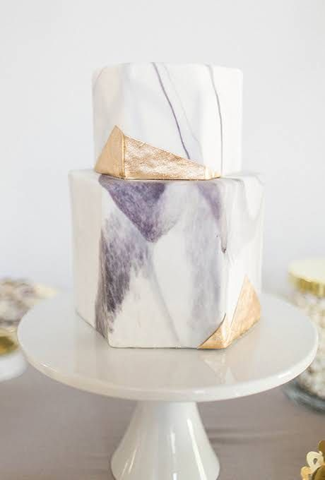 marble hexagon wedding cake with lilac and gold touches