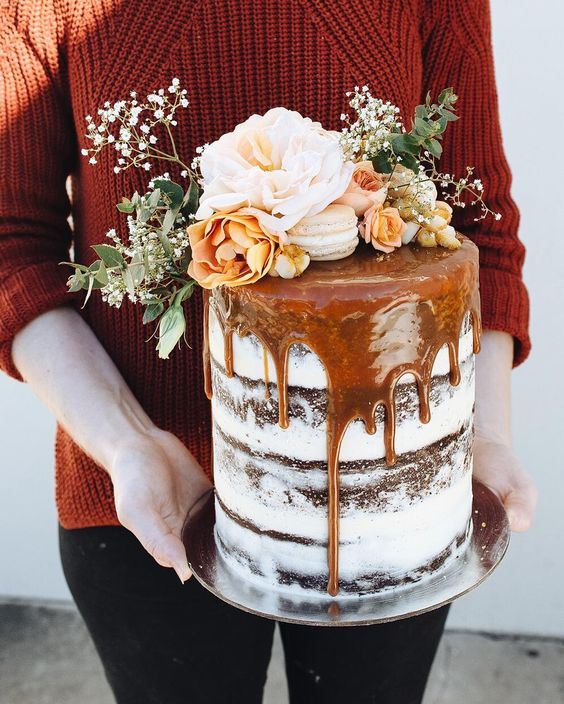 semi naked chocolate cake with salted caramel drip, fresh blooms and macarons