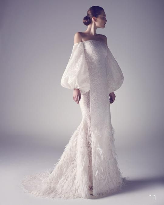 off the shoulder wedding dress with bell sleeves and a feathered skirt for a winter bride