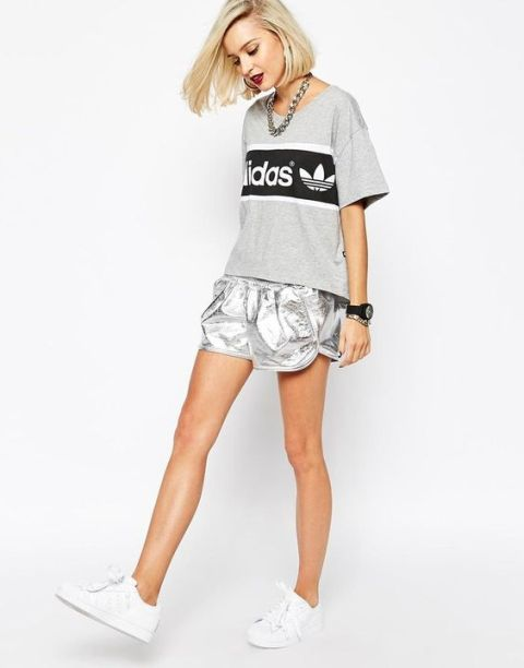 With loose t-shirt and white sneakers