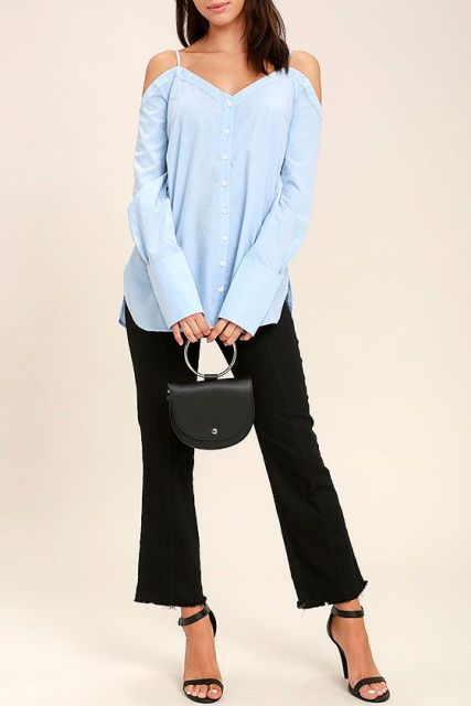With light blue off the shoulder blouse, black trousers and black ankle strap sandals