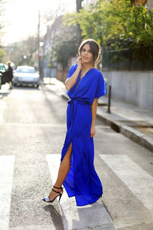 cobalt blue maxi dress with a side slit and a V-neckline, metallic heels