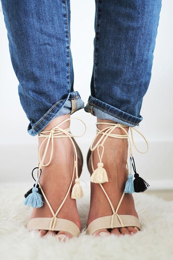 beige heeled sandals with colorful tassels