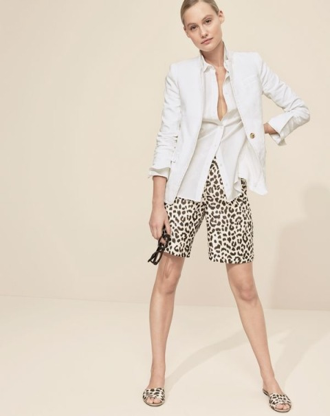 With white shirt, white blazer and printed slide sandals