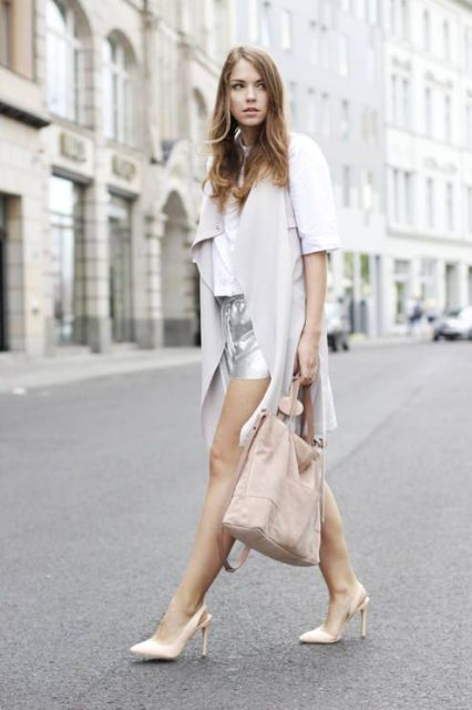 With white shirt, beige pumps, light gray vest and tote