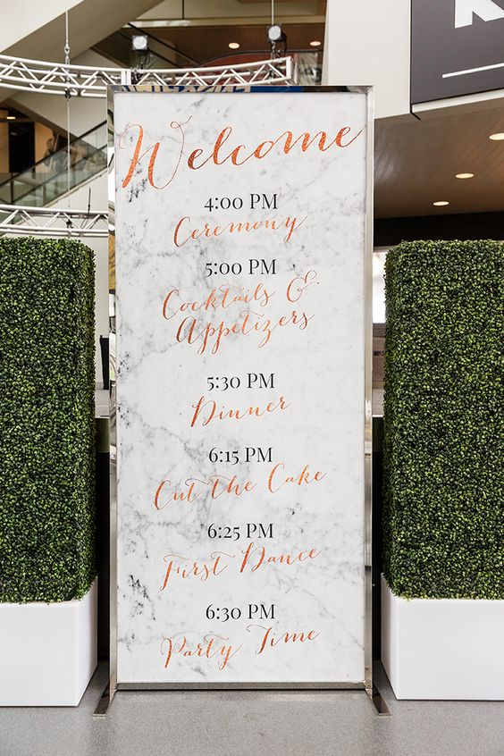 oversized marble wedding program with copper calligraphy