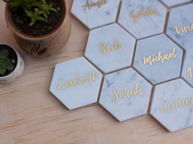 marble place cards with gold calligraphy in hexagon shape