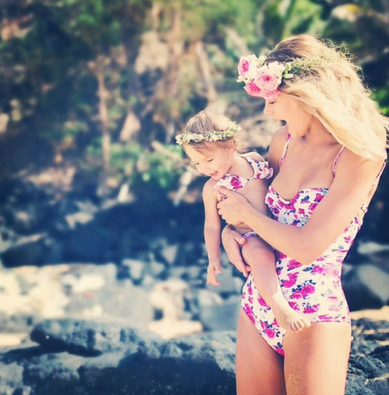 a pink floral one piece swimsuit for the mom and two piece for the daughter