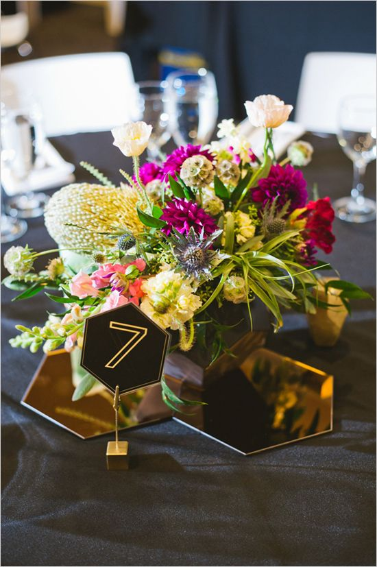 metallic hexagon tiles for accentuating a centerpiece and hexagon table numbers