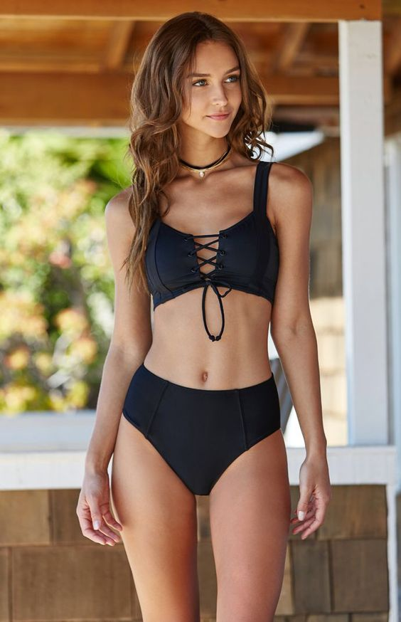 black retro-inspired bikini with a lace up top and a high waist bottom