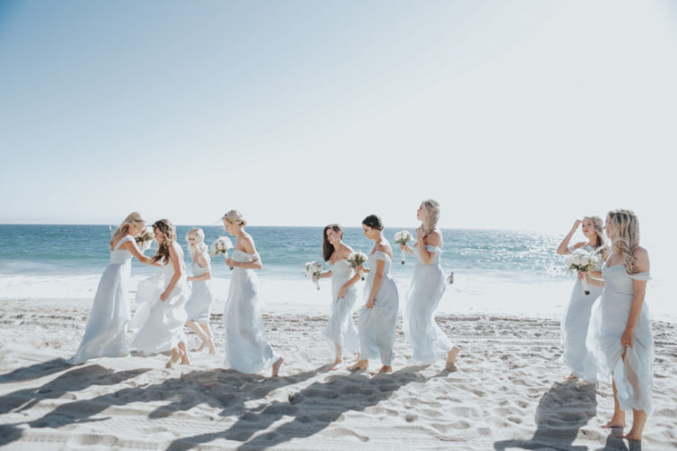 The bridesmaids were wearing icy blue off the shoulder dresses, flowy and comfy