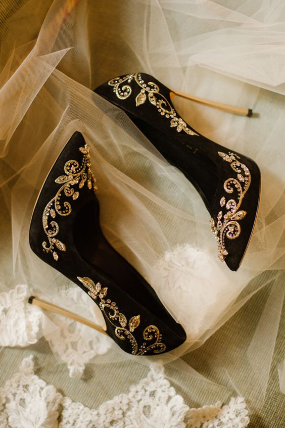 black suede stiletto heels with gold detailing and rhinestones