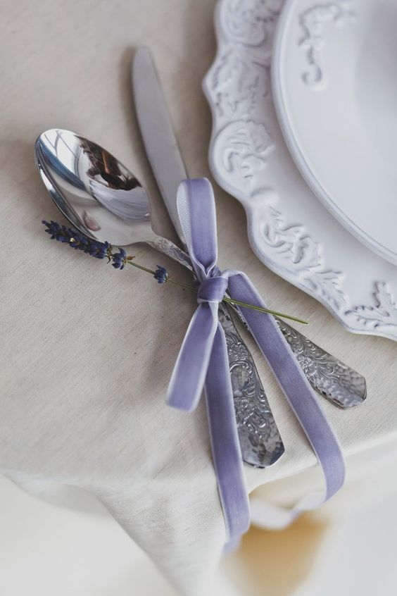 silverware with lavender-colored velvet ribbon and lavender itself looks cute