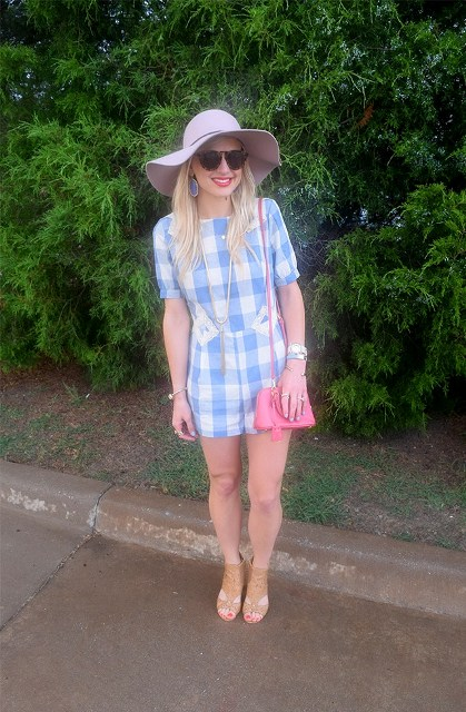 With pink bag, beige sandals and wide brim hat