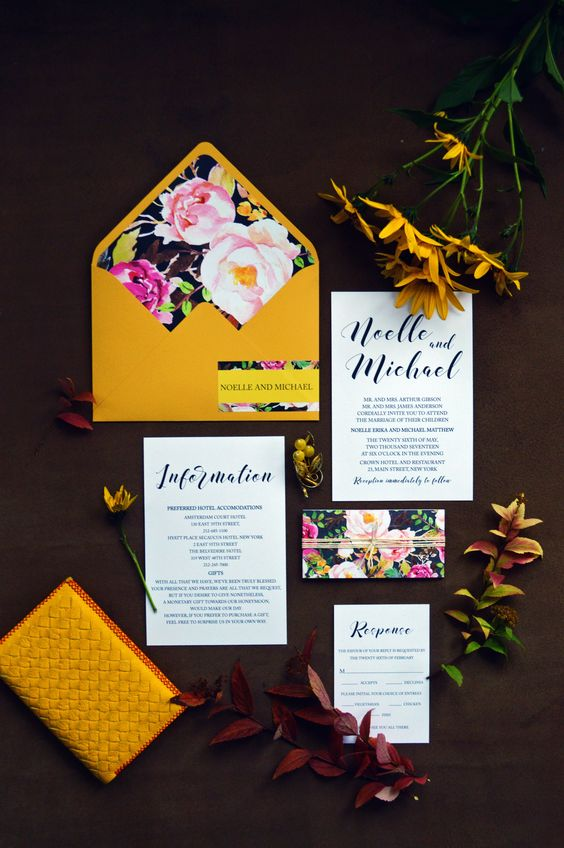 gorgeous mustard wedding invitation suite with floral lined envelopes