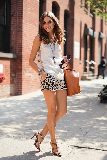 With white top, brown bag and printed heels