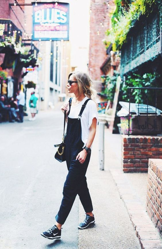 an oversized white t-shirt, a navy denim overall and black chucks