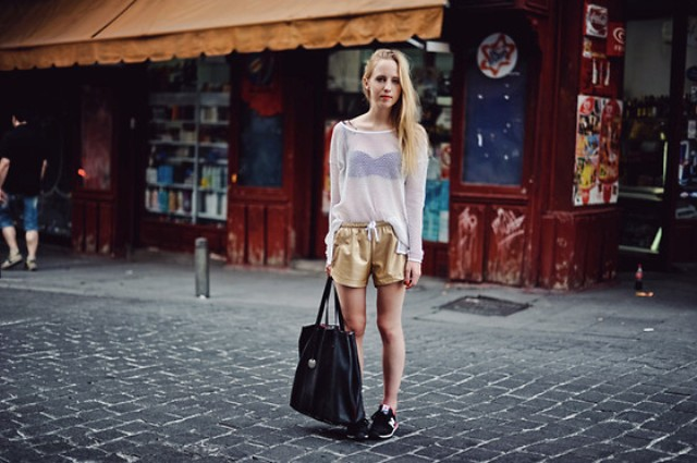 With sheer shirt, sneakers and black tote