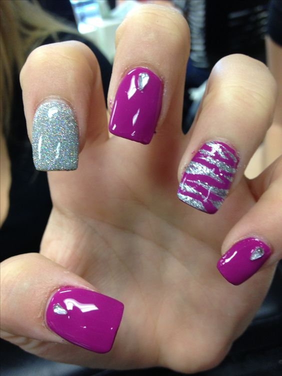purple and silver glitter nails and accent nails with an abstract pattern