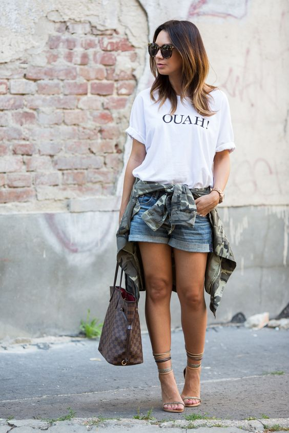 a printed oversized white t-shirt, denim shorts, ankle strap shoes