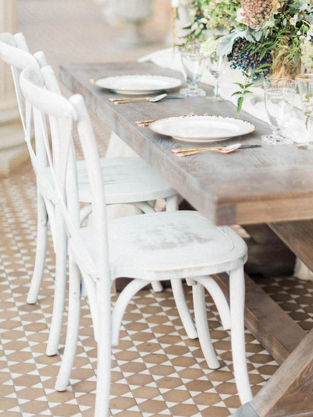 Shabby chic white farm table wedding reception chairs   Kaylee Sorrells Photography