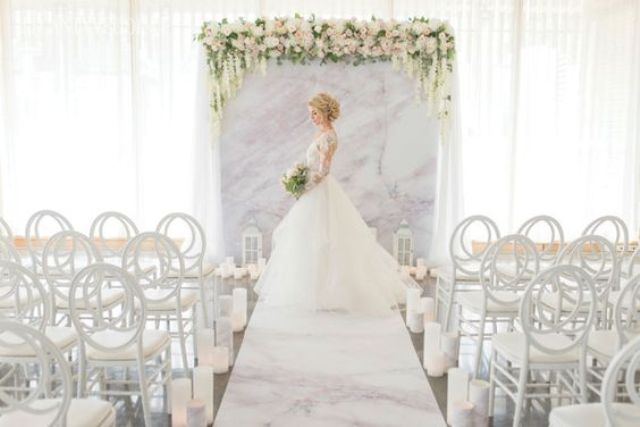 pink marble wedding backdrop, aisle runner and floral decor