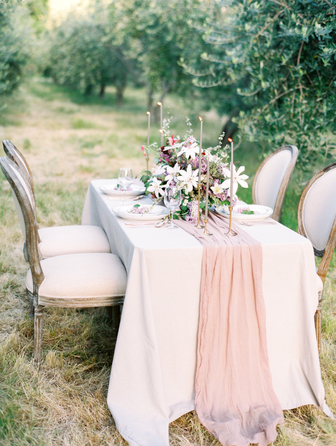 The wedding tablescape was also gentle and romantic, with thin candles and an airy fabric table runner