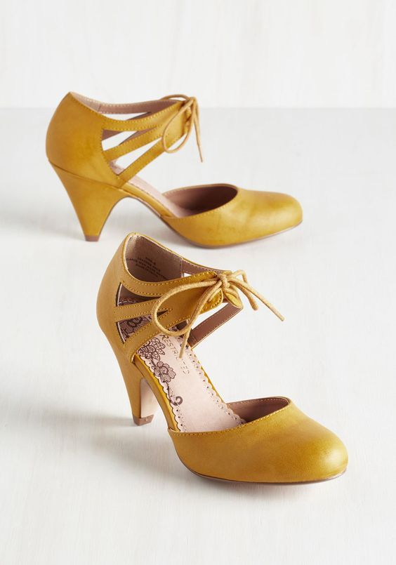 retro-inspired mustard lace up heels