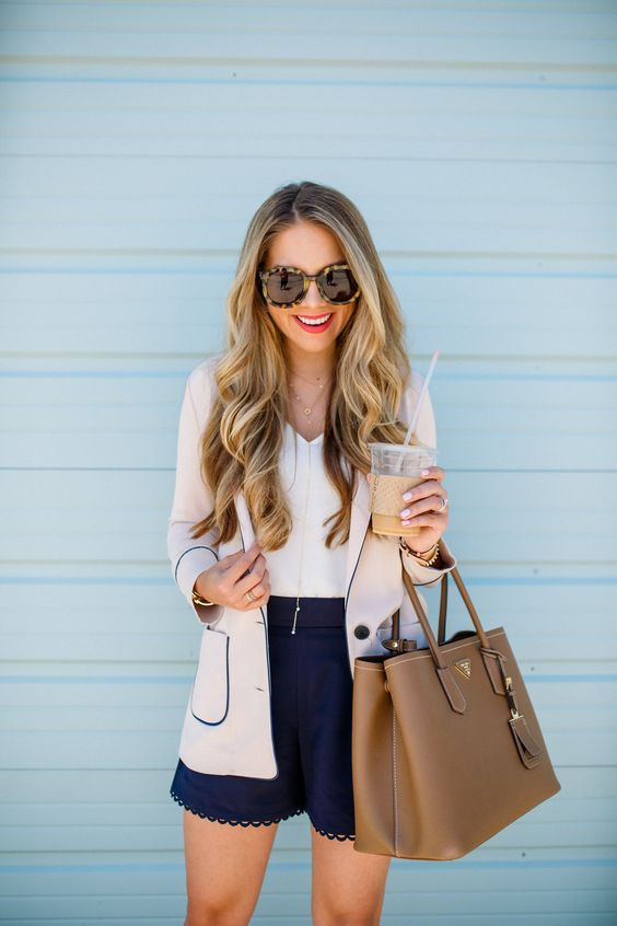 navy lace trim shorts, a white V-neckline top, a grey and navy blazer and a brown leather bag