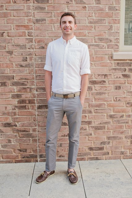 With white shirt, gray trousers and belt