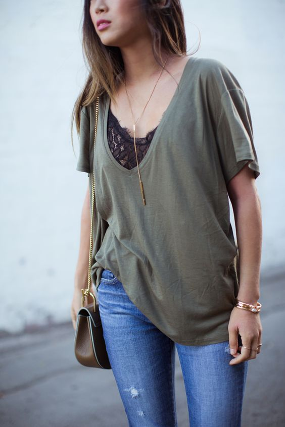 a black lace bralette with an oversized olive green tee and jeans for a sexy casual look