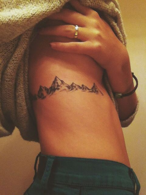 Gorgeous mountain tattoo on the right side