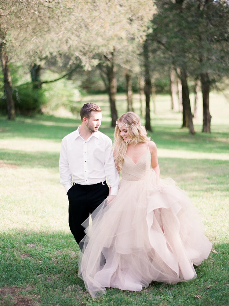 blush pink wedding dresses - photo by Christy Wilson Photography http://ruffledblog.com/summer-castle-soiree-wedding-inspiration