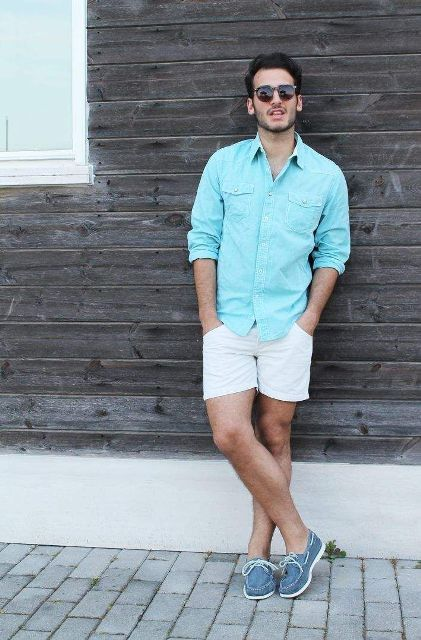 With light blue shirt and white shorts