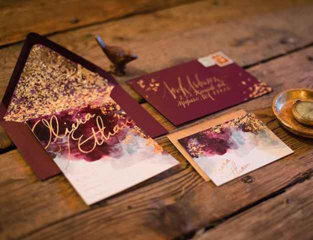 burgundy and gold leaf invitation suite with calligraphy