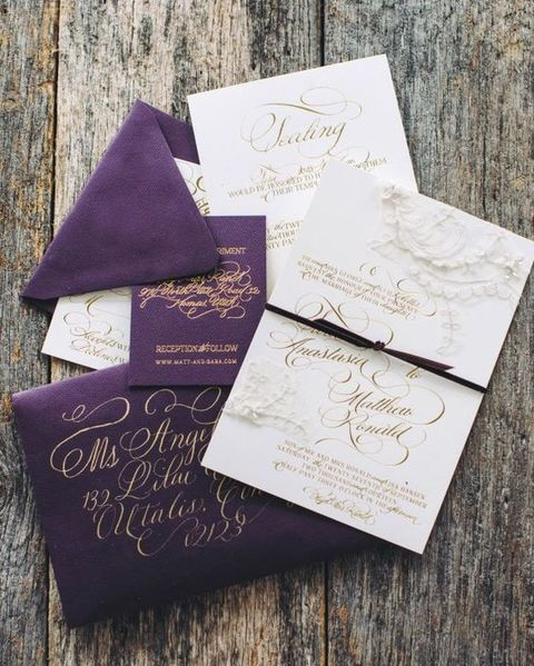 deep purple and gold calligraphy wedding stationary