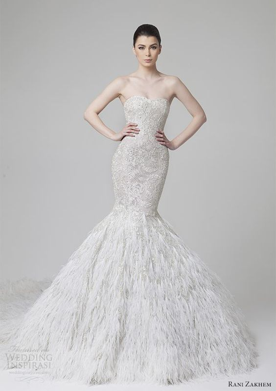 strapless sweetheart neckline lace and heavily embellished mermaid wedding dress with a feather skirt