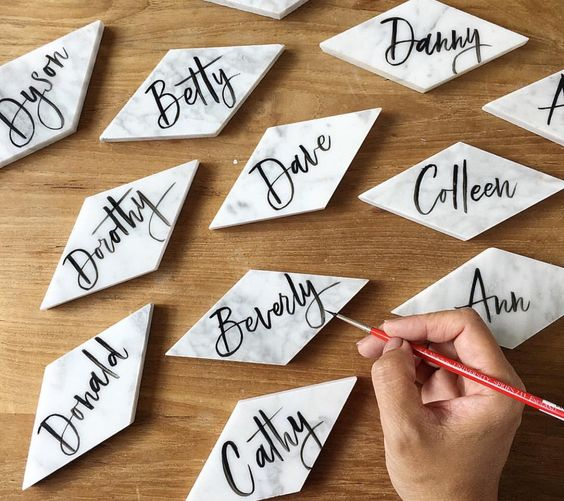geometric marble place cards with black calligraphy is a chic modern idea