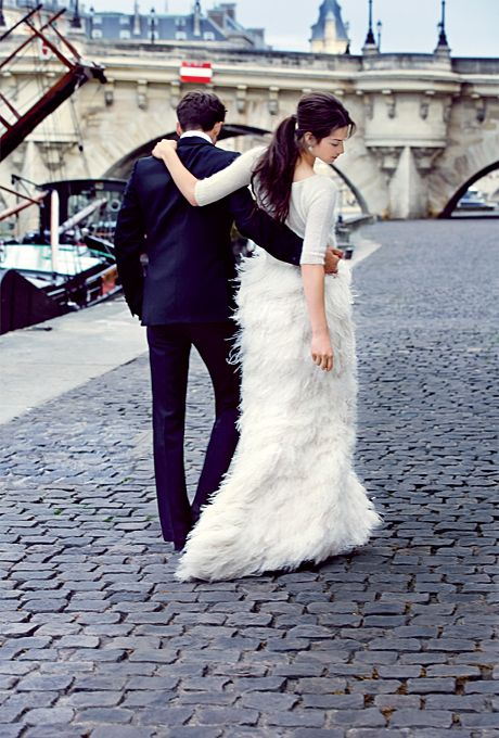 a flirty wedding separate with a plain bodice and half sleeves and a feather skirt