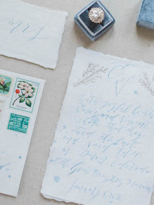 Romantic calligraphy wedding invitation with flower stamps   Kaylee Sorrells Photography