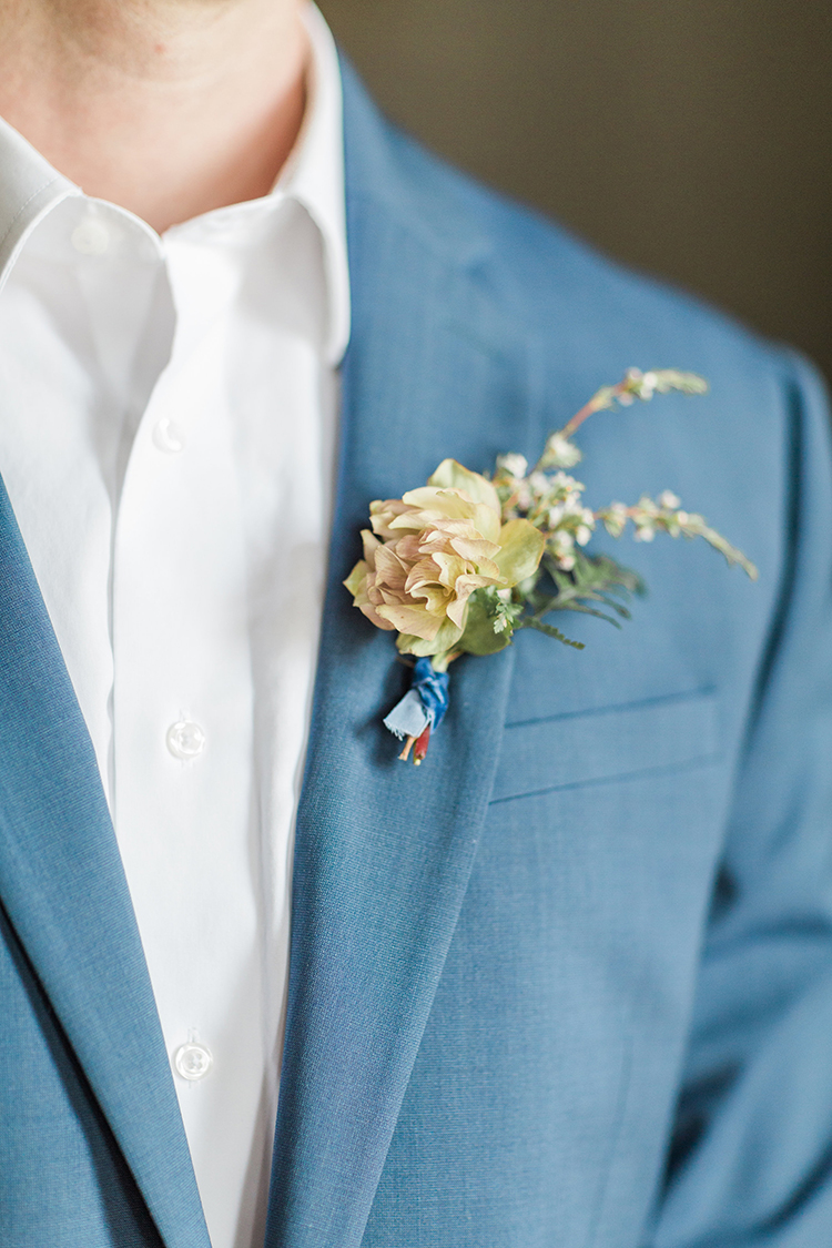 yellow groom boutonnieres - photo by Chloe Luka Photography http://ruffledblog.com/vintage-bohemia-wedding-ideas-with-statement-floral-arrangements
