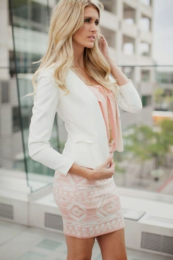 a pink printed mini skirt, a pink top and a white jacket