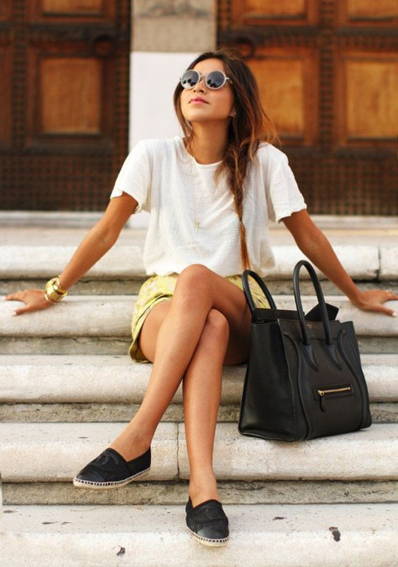 an oversized white tee, a yellow mini skirt, black flats and a bag