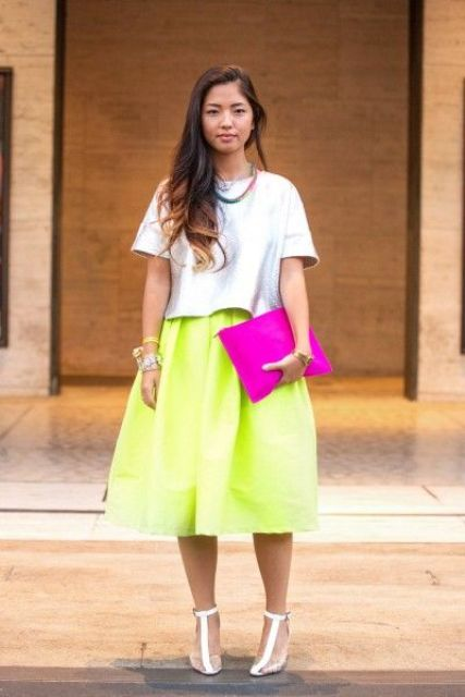 an oversized light blue tee, a neon green midi skirt, T ankle strap shoes