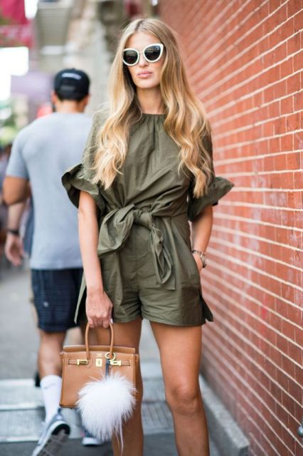 With brown bag and oversized sunglasses