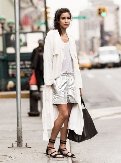 With white top, black lace up sandals, black tote and white light coat