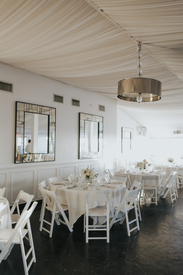 The reception was also decorated in all-white, with mirroring and metallic touches for a chic look
