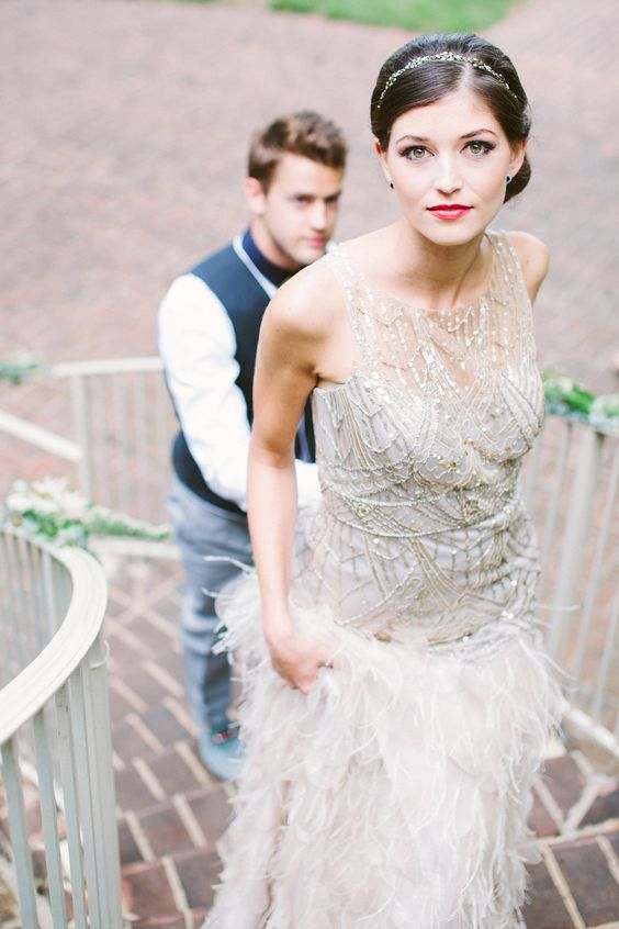 sparkling silver bodice sleeveless wedding dress with a feathered skirt
