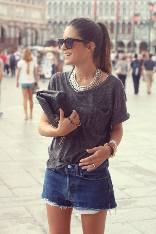 an oversized grey tee, denim shorts and lots of accessories create a chic look