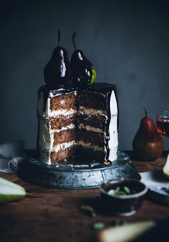 pear cardamom cake with brown butter frosting and chocolate drizzle